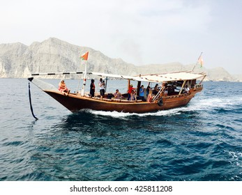 Musandam, Oman - 30th March 2016: Tourists on Dhow cruise trip in Sea of Oman, in Musandam, Sultanate of Oman