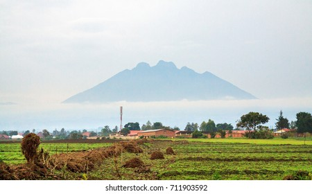 MUSANZE, RWANDA -  Mt Sabinyo volcano seen from the city of Musanze (former Ruhengeri) surrounded by morning mist. It stands at the border with and DRC in Volcanoes National Park