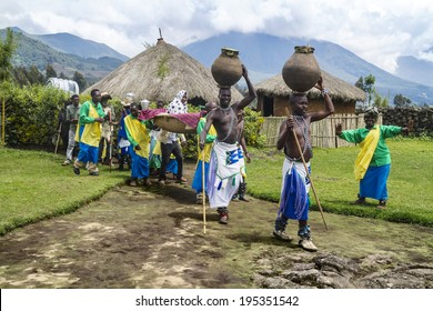 MUSANZE, RWANDA - NOVEMBER 5: Tribal ritual of the Batwa Tribe Perform Traditional Intore Dance to Celebrate the Birth of an Endangered Mountain Gorilla on November 5, 2013 in Musanze, Rwanda.