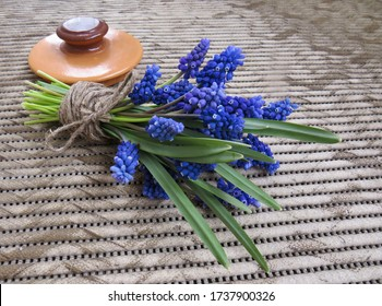 Muscari bouquet tied with linen rope