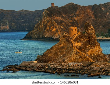 Muscat bay in Oman, Arabic Peninsula. The Persian Sea, flowing into the Indian ocean, formed a beautiful color contrast with the steep mountains with castles.
