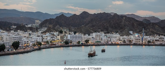 Muscat capital of Oman at dusk seen from the port