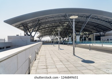 Muscat International Airport in Oman on blue sky background. Side view of Terminal 1.