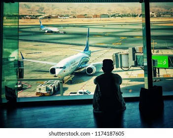 Muscat, Muscat/Oman - Sept 7, 2018: People Silhouettes in Airport waiting area, Muscat Oman