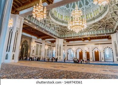 Muscat / Oman - 03.19.2019; Interior of Sultan Qaboos Grand Mosque in Muscat, Oman. The main prayer room with hand-woven rug, beautifully decorated vault and Swarovski chandelier.