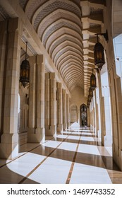 Muscat / Oman - 03.19.2019; Passage in Sultan Qaboos Grand Mosque in Muscat, Oman. White marble floor, columns and arch vault.