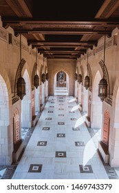 Muscat / Oman - 03.19.2019; Passage in Sultan Qaboos Grand Mosque in Muscat, Oman. White marble floor, columns and wooden vault.