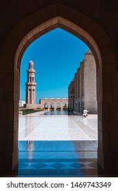 Muscat / Oman - 03.19.2019; View on Sultan Qaboos Grand Mosque in Muscat, Oman. White marble floor and door vault.