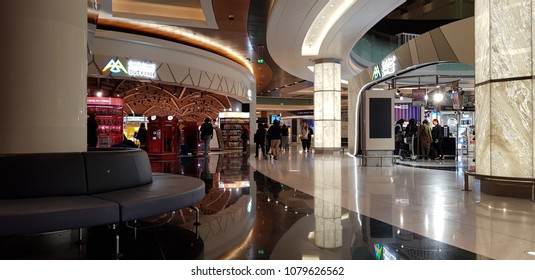 Muscat, Oman, 17 April 2018: Passengers strolling among the many duty free shops at the new Muscat International Airport.