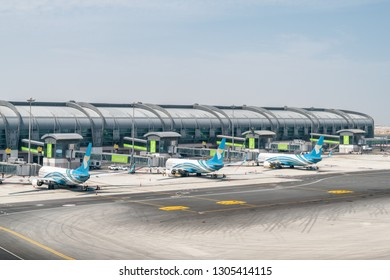 Muscat, Oman - 17 October, 2018: Three Oman Air aircraft parked on the apron of Muscat International Airport. The airport is the main base of the national airline. View of gates at departure area.