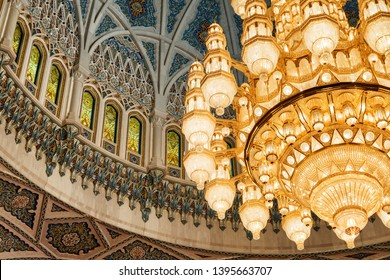 Muscat, Oman - 17 October, 2018: View of ceiling and chandelier above the main prayer hall of the Sultan Qaboos Grand Mosque. Wonderful details of amazing interior of the Muslim place.