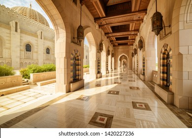 Muscat, Oman - 17 October, 2018: View of deserted arched passageway at the Sultan Qaboos Grand Mosque. Islamic architecture. The Muslim place is a popular tourist attraction of the Middle East.
