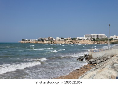 Muscat / Oman - April 19 2018: A photograph of Qurum beach at high tide in Muscat, Oman with hotels in the background.