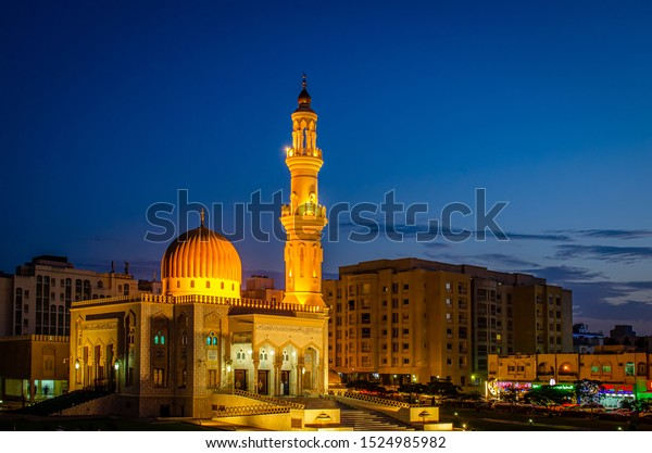 Muscat, Oman - August 24th, 2019: The Beautiful Al Zawawi Mosque bathed in Orange Light in the night. From Muscat, Oman.