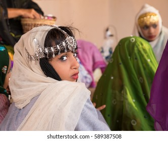 Muscat, Oman - Feb 4, 2017: Young Omani girl during a traditional wedding ritual display at Muscat cultural festival.