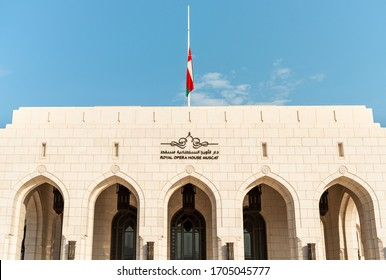 Muscat, Oman - February 11, 2020: Facade of the Royal Opera House with national flag of Oman in Muscat, Sultanate of Oman