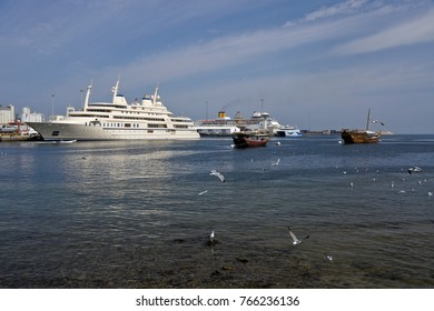 """MUSCAT, OMAN, FEBRUARY 18, 2013. The """"Al Said,"""" luxurious yacht of Sultan Qaboos, can often be seen in Mutrah Harbor along with cruise ships and wooden dhows."""