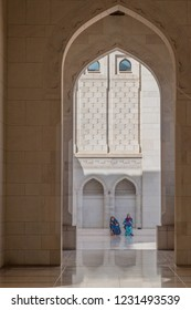MUSCAT, OMAN - FEBRUARY 22, 2017: Visitors of Sultan Qaboos Grand Mosque in Muscat, Oman
