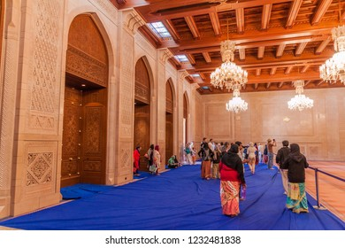 MUSCAT, OMAN - FEBRUARY 22, 2017: Visitors in a small prayer hall of Sultan Qaboos Grand Mosque in Muscat, Oman