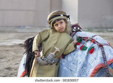 Muscat, Oman, February 4th, 2017: young omani boy in traditional clothing