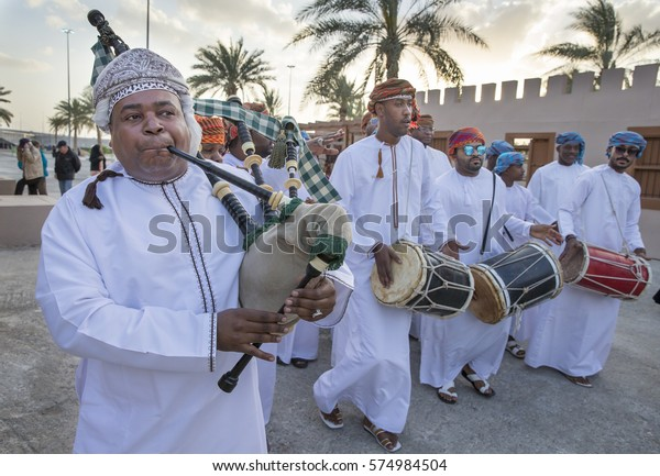 Muscat, Oman, February 4th, 2017: omani men celbrating with songs and dances