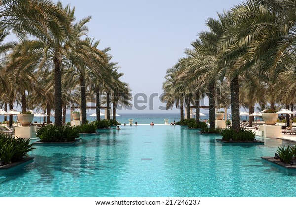 MUSCAT, OMAN - JUNE 10: Swimming pool of the Al Bustan hotel in Muscat. June 10, 2011 in Muttrah, Sultanate of Oman, Middle East