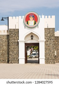 Muscat, Oman - November 1, 2018: Entrance portal to the government ministries area in Muscat with the effigy of the Sultan Qaboos with nobody