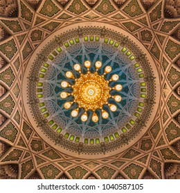 MUSCAT, OMAN - NOVEMBER 30, 2017: Interior view of dome of  Sultan Qaboos Grand Mosque in Muscat, Oman