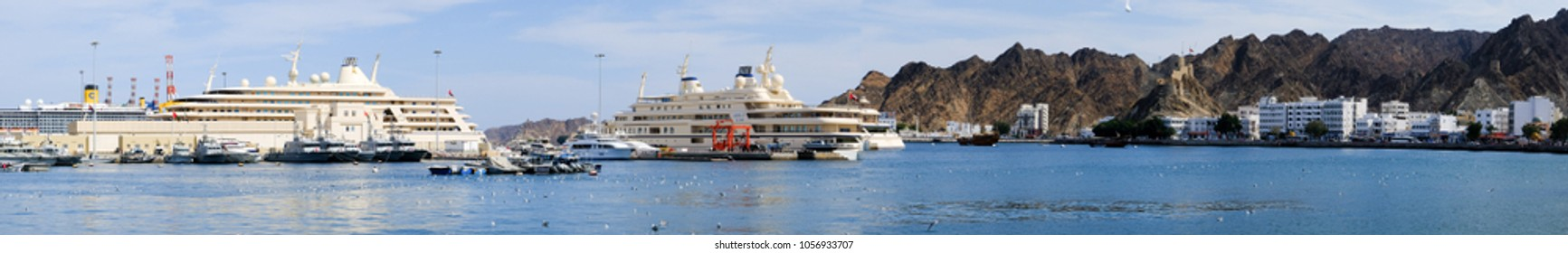 Muscat / Sultanate of Oman - Feb 17 2018: Panoramic view of the harbor of Muscat with the royal yacht Al Said in background.