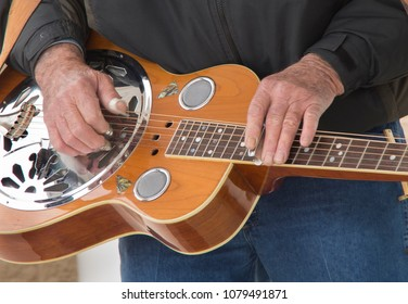 A muscian plays the Dobro in a Bluegrass Band in Myrtle Beach South Carolina