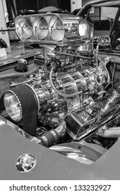 Muscle car engine close-up shot in black and white.