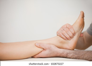 Muscle of a foot being massaged in a room