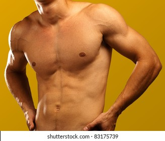 muscle man on a golden background