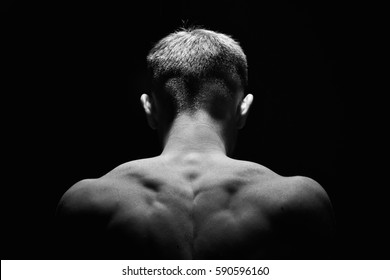 Muscle necj and back of man . Showing muscle .Low key.Black and white photo
