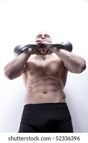 Muscle sexy males's body in gym with kettle bells