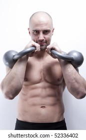 Muscle sexy males's body in gym with kettlebells