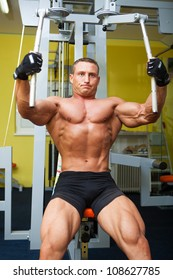 Muscle shaped man exercise on sport gym in fitness club