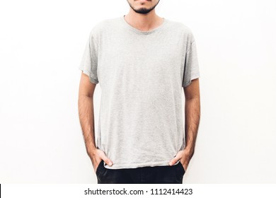 Muscle young man with blank grey t-shirt on white background.Shirt design and mock up template for print