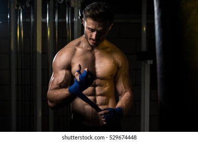Muscled Boxer Wearing Blue Strap On Wrist