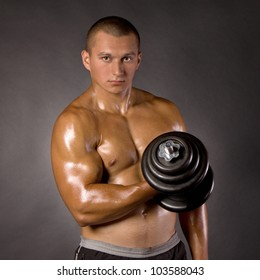 Muscled male bodybuilder weight, dumbbell, raise, swing