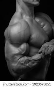 Muscled male model flexing biceps