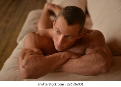 Muscled male model on white background
