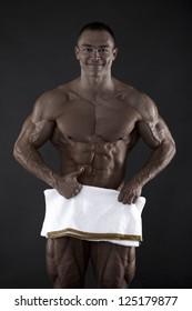 Muscled male model posing in studio