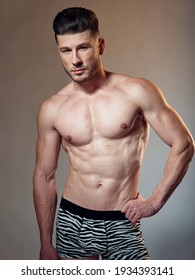 muscled man in underpants bodybuilder basing