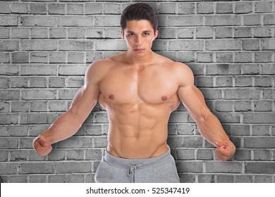 Muscles flexing posing bodybuilder bodybuilding strong muscular young man