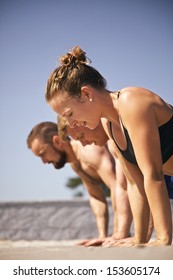 Muscular active people in 20s training to maintain healthy lifestyle.