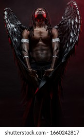 muscular african man with dreadlocks became dark angel and now live in heaven, unusual photoshot of naked angel with black big magnificent wings, fantastic extraordinary creature descended from heaven