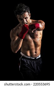 Muscular Aggressive Man Showing His Fist isolated on black background