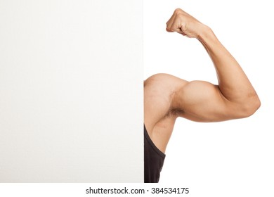 Muscular Asian man arm flexing biceps behind  blank sign  isolated on white background