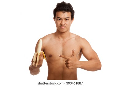 Muscular Asian man point to banana  isolated on white background